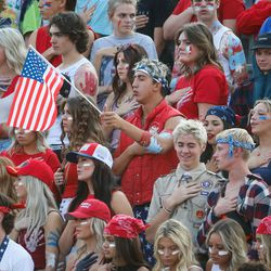 Wasatch high school students sing the national anthem before a high school football game against Mountain Ridge High on Friday, Aug. 27, 2021, at Wasatch High School in Heber City.