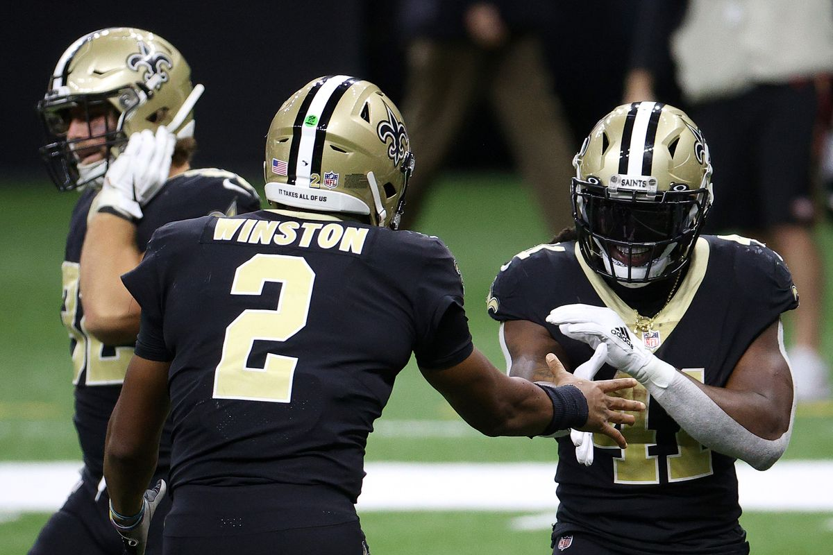 Alvin Kamara #41 and Jameis Winston #2 of the New Orleans Saints celebrate following a touchdown during their game against the San Francisco 49ers at Mercedes-Benz Superdome on November 15, 2020 in New Orleans, Louisiana.
