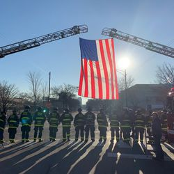 The Chicago Fire Department prepares to salute the fallen 23-year-old off-duty Chicago Police officer.   Sam Kelly