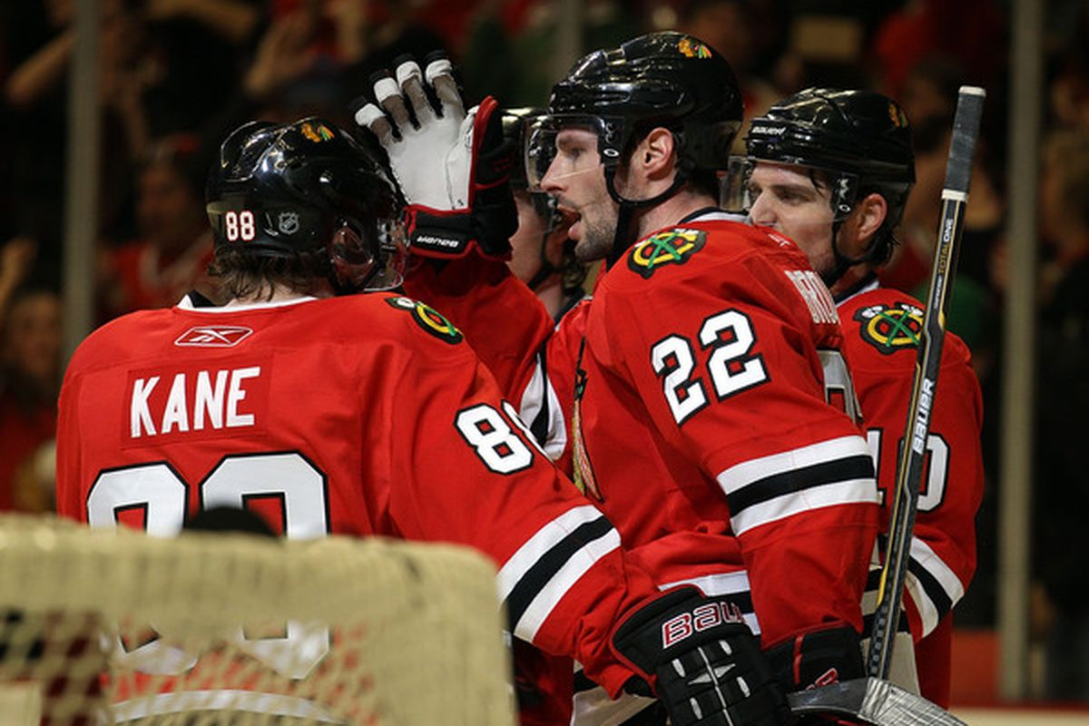 Troy Brouwer of the Chicago Blackhawks celebrates a 2nd period goal against the San Jose Sharks with teammates including Patrick Kane and Patrick Sharp at the United Center in Chicago Illinois. (Photo by Jonathan Daniel/Getty Images)