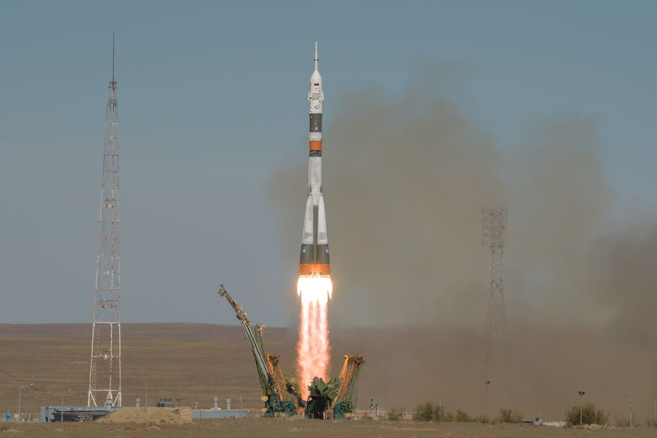 <em>The Russian Soyuz rocket lifts off carrying Nick Hague and Alexey Ovchinin</em>