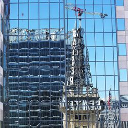 The Walker Center is reflected in windows in downtown Salt Lake City on Tuesday, May 3, 2016, as local business leaders and elected officials gather to discuss the Downtown Rising projects and its priorities for the next 10 years.