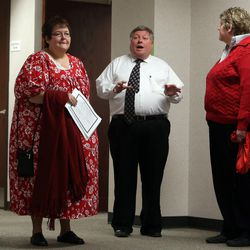 Shelly Eyre, left, Utah County Clerk and Auditor Bryan Thompson, and Cheryl Haws speak to reporters after Eyre and Haws received a marriage license at the Utah County Clerk's Office in Provo on Thursday, Dec. 26, 2013. Eyre and Haws served the Utah County Clerk's Office with a lawsuit Monday after the clerk's office refused to grant them a marriage license.
