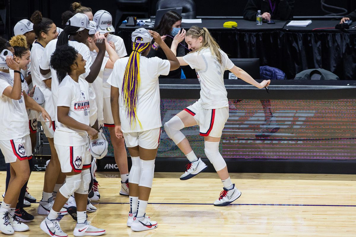 UConn Huskies celebrate after defeating the Marquette Golden Eagles to win the Women's Big East Conference Tournament championship on March 8, 2021, at Mohegan Sun Arena in Uncasville, CT.