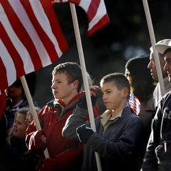 People watch the funeral procession for fallen Ogden police officer Jared Francom  on Washington Boulevard in Ogden on Wednesday, January 11, 2012.  Officer Francom was shot and killed last week while serving a search warrant  with members of the Weber-Morgan Narcotics Strike Force.