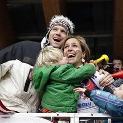 Noelle Pikus-Pace of the United States celebrates with her brother Jared Pikus, left, husband, Janson Pace, far right, and children, Traycen, left, and Lacee, right, after she won the silver medal during the women's skeleton competition at the 2014 Winter Olympics, Friday, Feb. 14, 2014, in Krasnaya Polyana, Russia.