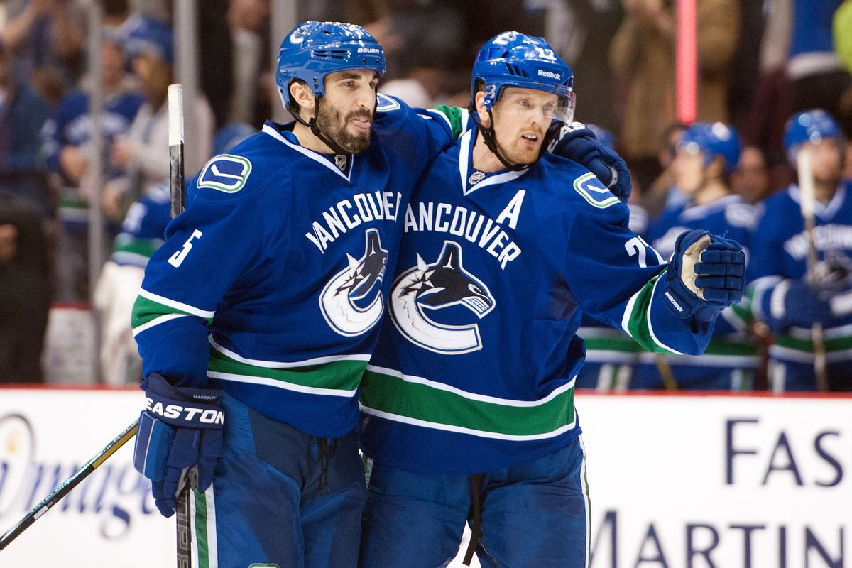 Sedin and Garrison celebrate after scoring a power play goal