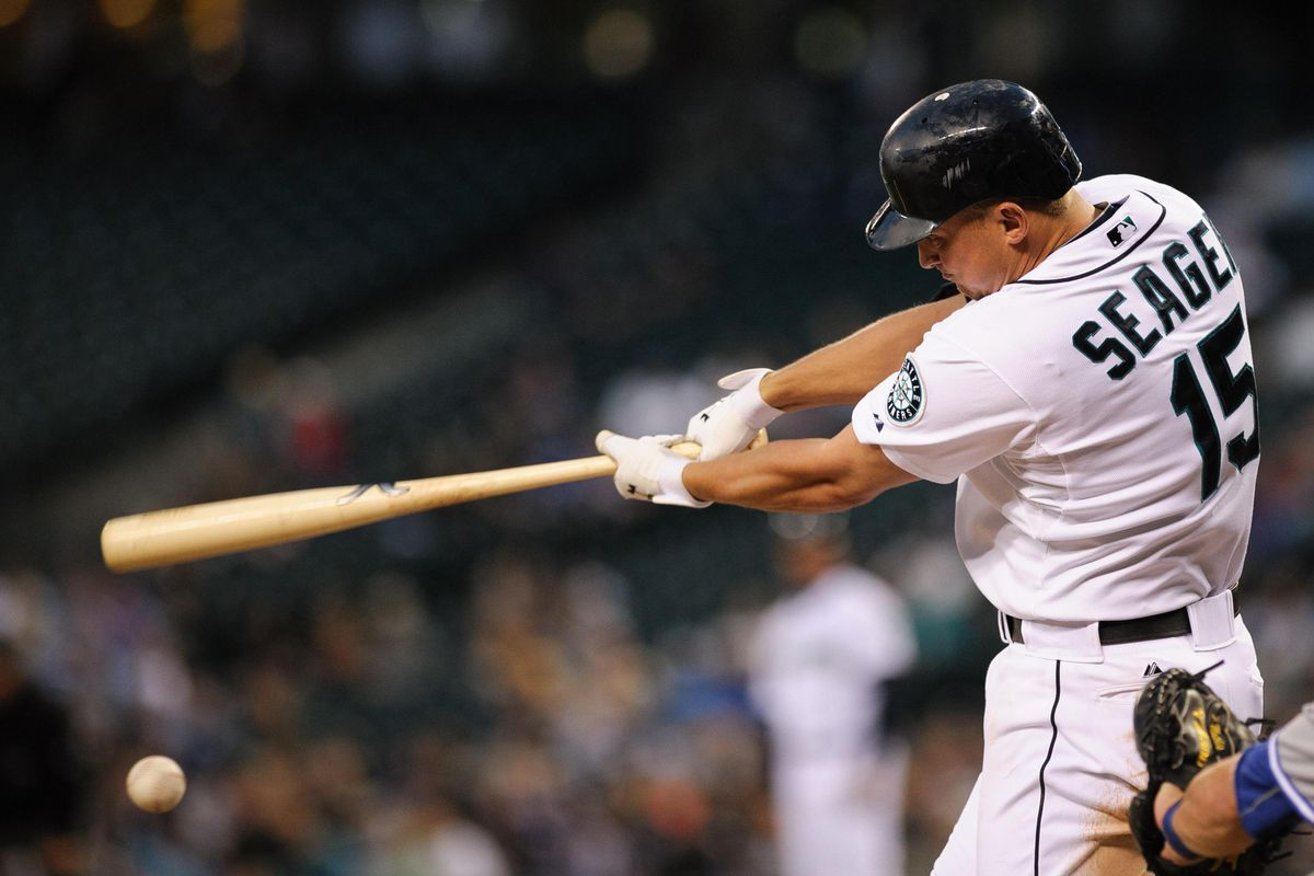 Jul 31, 2012; Seattle, WA, USA; Seattle Mariners third baseman Kyle Seager (15) hits a single against the Toronto Blue Jays during the 5th inning at Safeco Field. Seattle defeated Toronto 7-2. Mandatory Credit: Steven Bisig-US PRESSWIRE