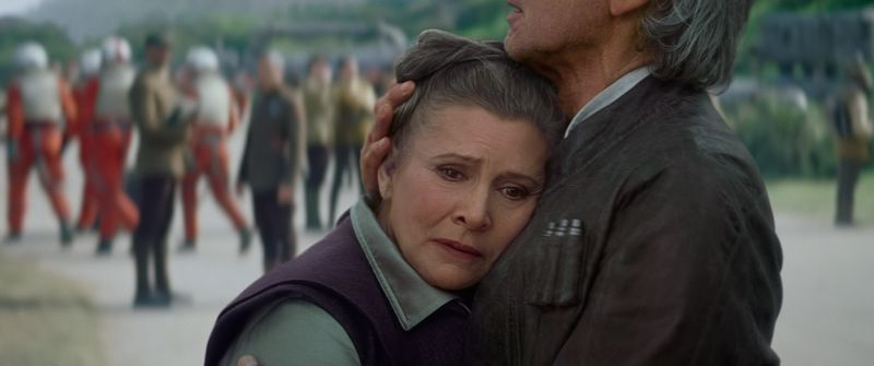 Han and Leia sharing a hug in The Force Awakens.