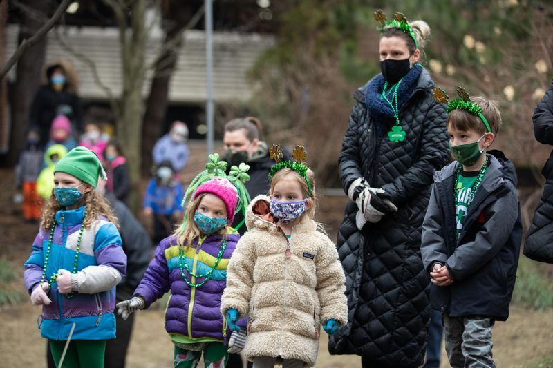 Children of health care workers and staff watch Trinity Irish Dancers perform outside Swedish Covenant Hospital on St. Patrick's Day.