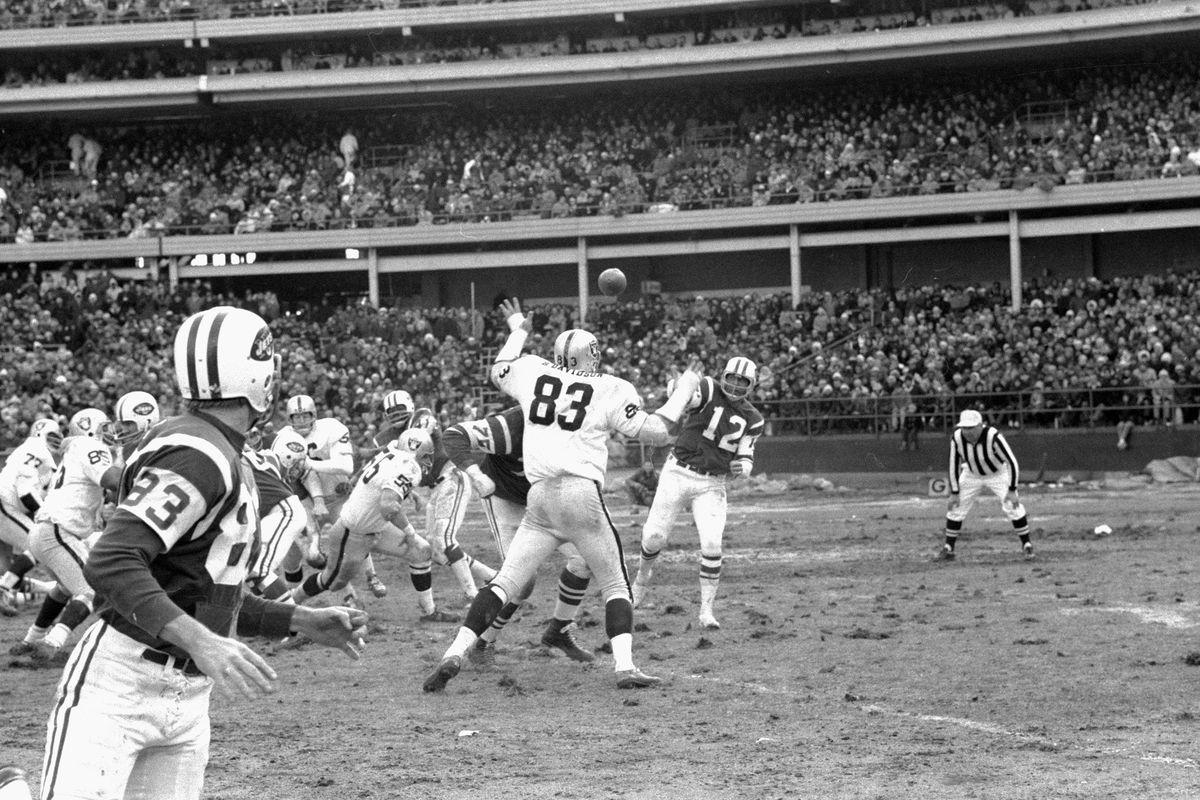 New York Jets' quarterback Joe Namath (12) fires a spiraling