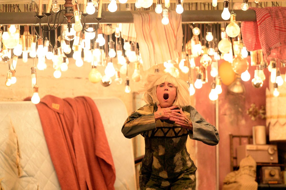 Kristen Wiig dances to Sia's Chandelier at the 57th Grammy Awards.
