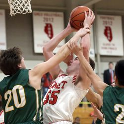 Benet Academy's Colin Crothers (55) shoots between Stevenson's Jacob Tenner (20) and Luke Chieng (2) in Lisle, Saturday, February 16, 2019.   Kevin Tanaka/For the Sun Times