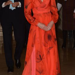 Attending a reception at Bhutan's Taj Hotel on April 15th, 2016 in a red Beulah London gown.