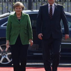 Czech Republic's Prime Minister Petr Necas, right, welcomes German Chancellor Angela Merkel, left, at the government's headquarters in Prague, Czech Republic, Tuesday, April 3, 2012. Merkel is in Czech Republic on a one-day official visit.