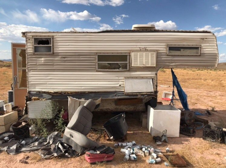 A camper, including trash and hazardous materials, was left behind at a campsite on Bureau of Land Management land.