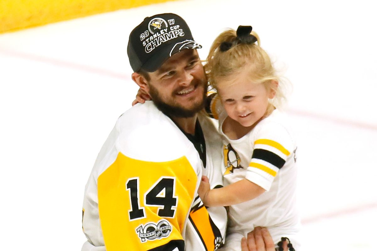 621d15f13 Stanley Cup Joy  The Penguins  families celebrate on the ice after the game