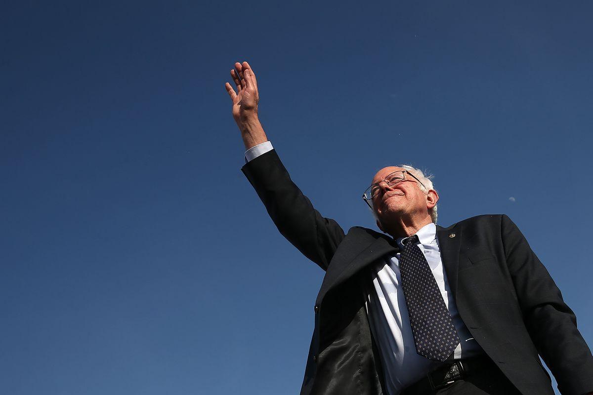 Bernie Sanders waves.