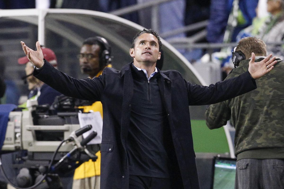 This was what Jay Heaps looked like late Saturday night. Just on a roof with a fifth of Jack in his right hand.