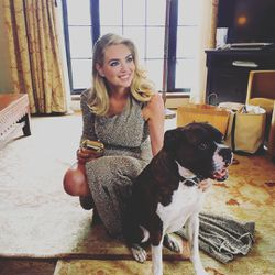 Kate Upton posing with a pup in her silver Topshop dress.