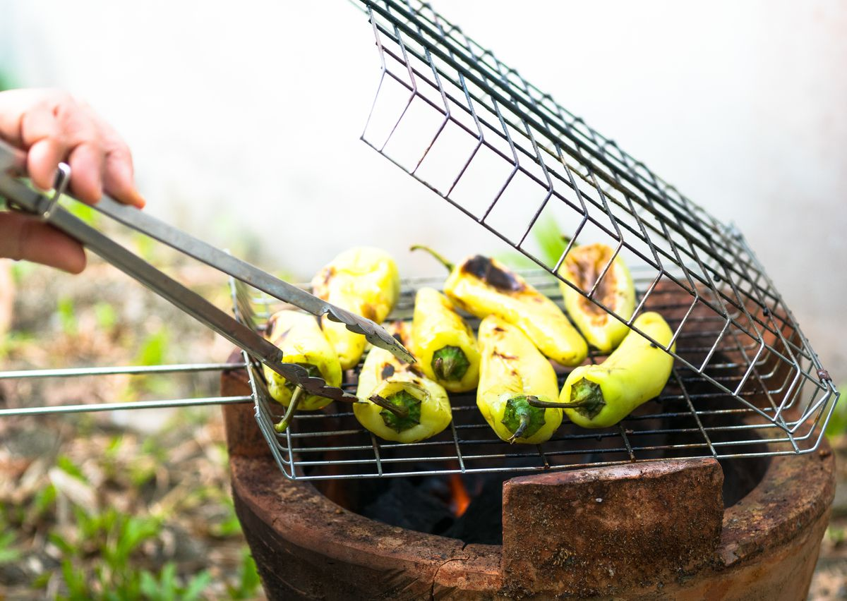 From tomatoes to peppers to asparagus, a grilling basket will help ensure the vegetables don't stick to the grates of your barbecue grill.