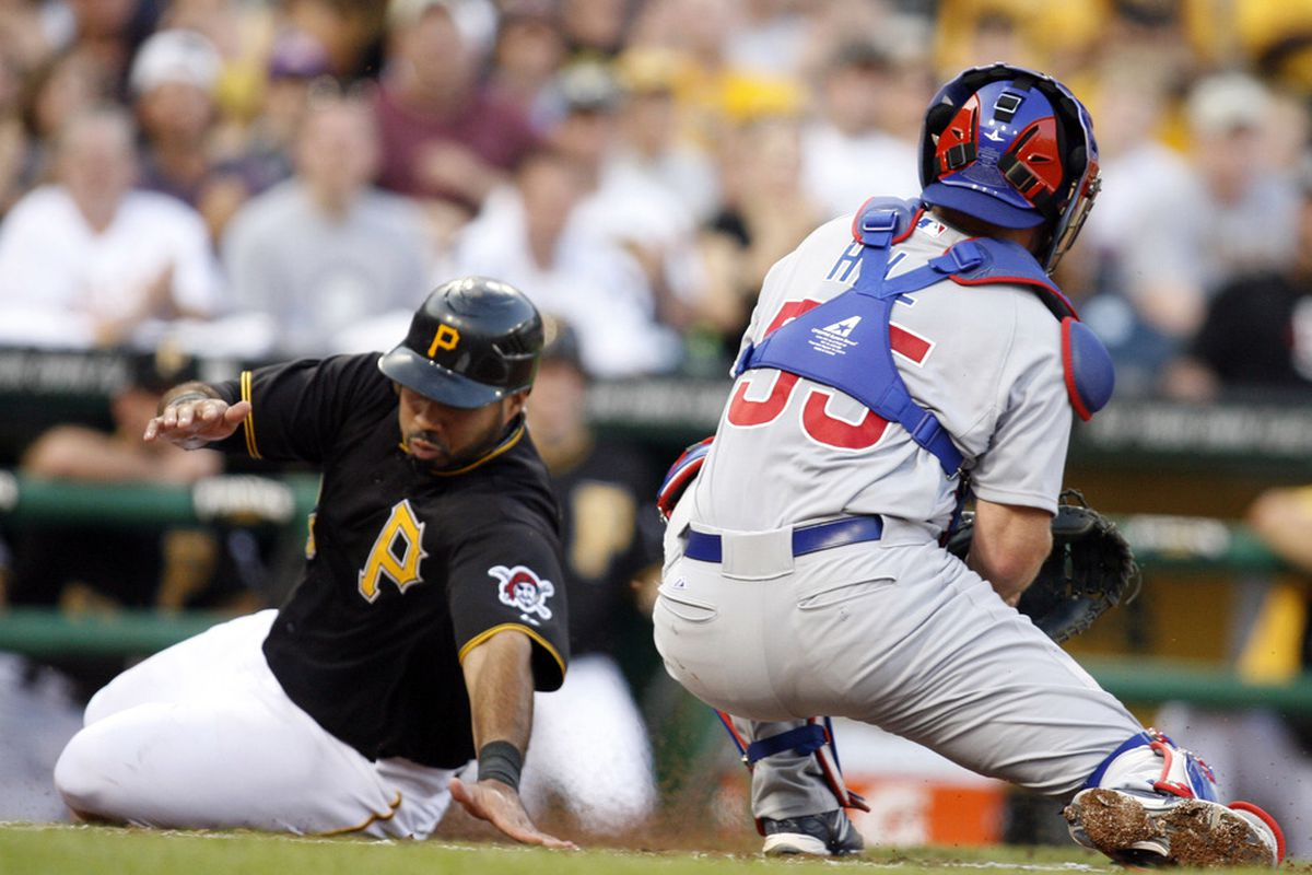 Pittsburgh, PA, USA; Pittsburgh Pirates third baseman Pedro Alvarez slides safely into home plate past Chicago Cubs catcher Koyie Hill during the second inning at PNC Park. Credit: Charles LeClaire-US PRESSWIRE
