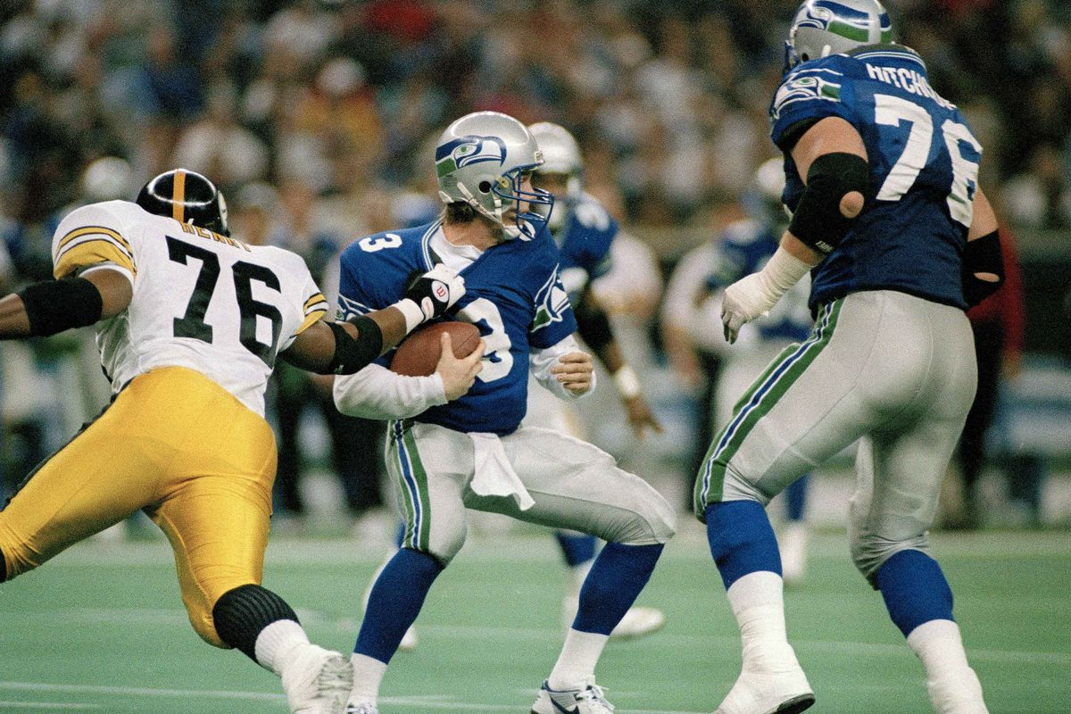 File-Seattle Seahawks quarterback, Rick Mirer (3) is sacked for a seven-yard-loss by Kevin Henry (76) of the Pittsburgh Steelers during the second quarter of their NFL game in Seattle, Wash., Sunday, Dec. 26, 1993.