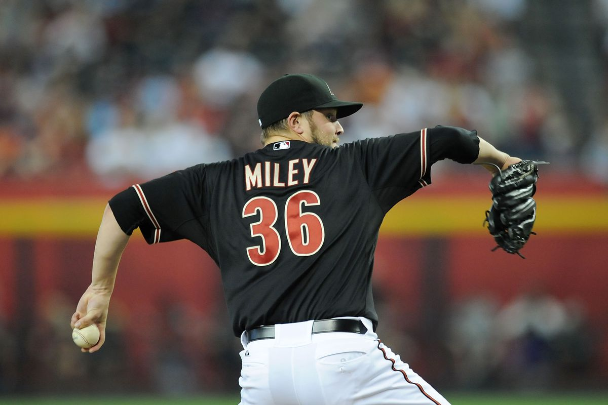 PHOENIX, AZ - AUGUST 11:  Wade Miley #36 of the Arizona Diamondbacks delivers a pitch against the Washington Nationals at Chase Field on August 11, 2012 in Phoenix, Arizona.  (Photo by Norm Hall/Getty Images)