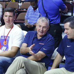 Jim Calhoun talks with Tom Moore while Tyler Olander listens.