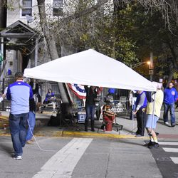 9:35 p.m. Rain starts coming down, so the ballhawk tent starts to go up -
