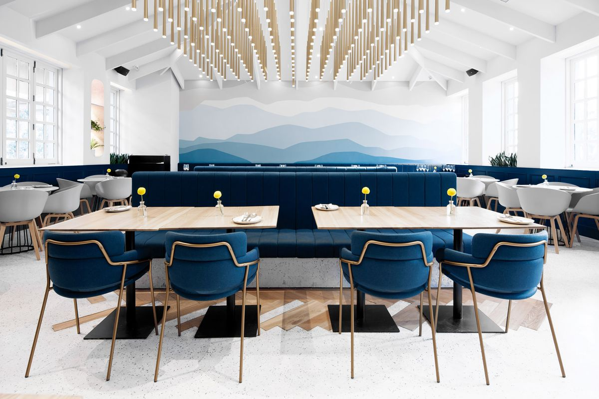 Interior of restaurant with blue chairs
