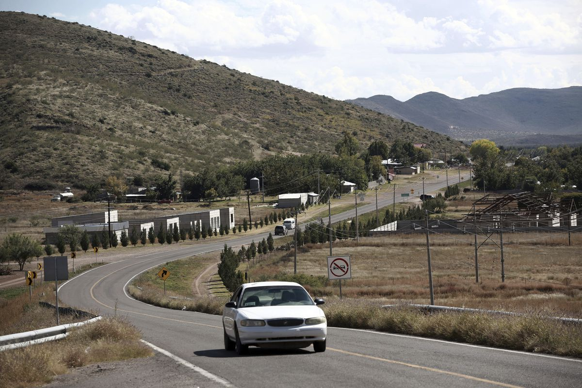 A car passes through Colonia LeBaron, one of many locations where the extended LeBaron family lives in the Galeana municipality of Chihuahua state in northern Mexico.