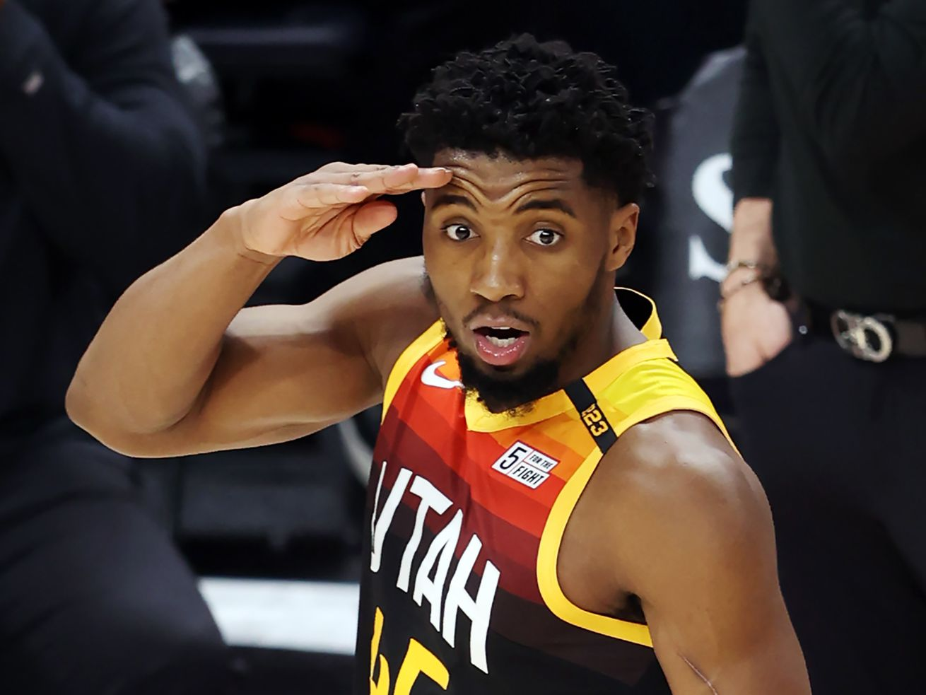 Utah Jazz guard Donovan Mitchell (45) salutes as the Utah Jazz and the Cleveland Cavaliers play an NBA basketball game at Vivint Smart Home Arena in Salt Lake City on Monday, March 29, 2021. Utah won 114-75.