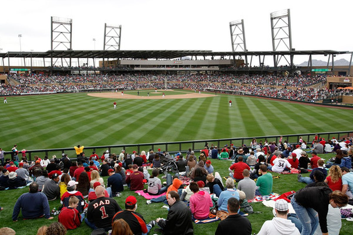 SCOTTSDALE, AZ:  Fans gather to watch the inaugural game at the new Salt River Fields between the Colorado Rockies and the Arizona Diamondbacks at Salt River Fields in Scottsdale, Arizona..  (Photo by Jonathan Ferrey/Getty Images)
