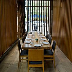 A wood-slatted private dining area