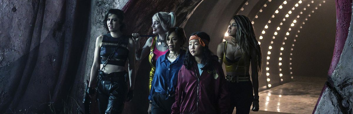 (L-r) MARY ELIZABETH WINSTEAD as Huntress, MARGOT ROBBIE as Harley Quinn, ROSIE PEREZ as Renee Montoya,ELLA JAY BASCO as Cassandra Cain and JURNEE SMOLLETT-BELL as Black Canary in walk out of a funhouse tunnel together in BIRDS OF PREY (AND THE FANTABULOUS EMANCIPATION OF ONE HARLEY QUINN).