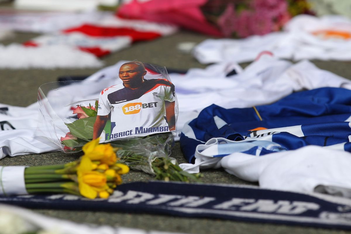 BOLTON, ENGLAND - MARCH 19:  Tributes and get well messages are laid outside the Reebok Stadium for Bolton Wanderers' Fabrice Muamba at Reebok Stadium on March 19, 2012 in Bolton, England.  (Photo by Alex Livesey/Getty Images)