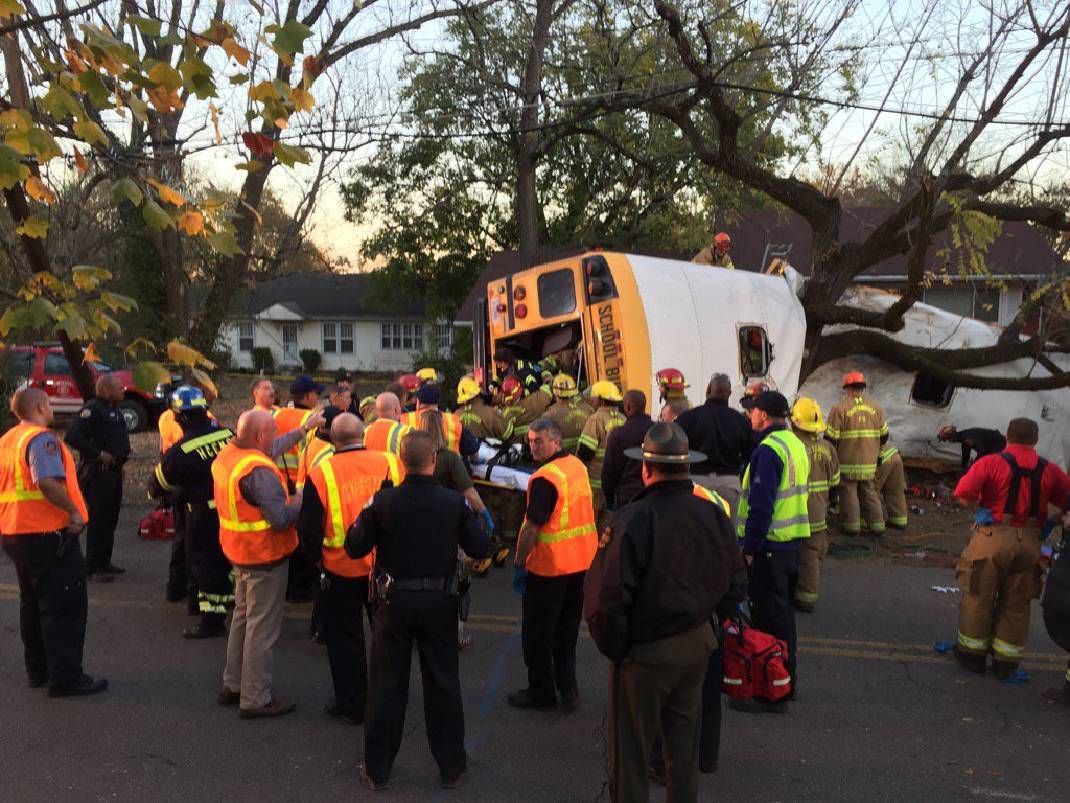 Emergency responders work to remove students from Woodmore Elementary School after a bus crashed on Nov. 21, 2016.