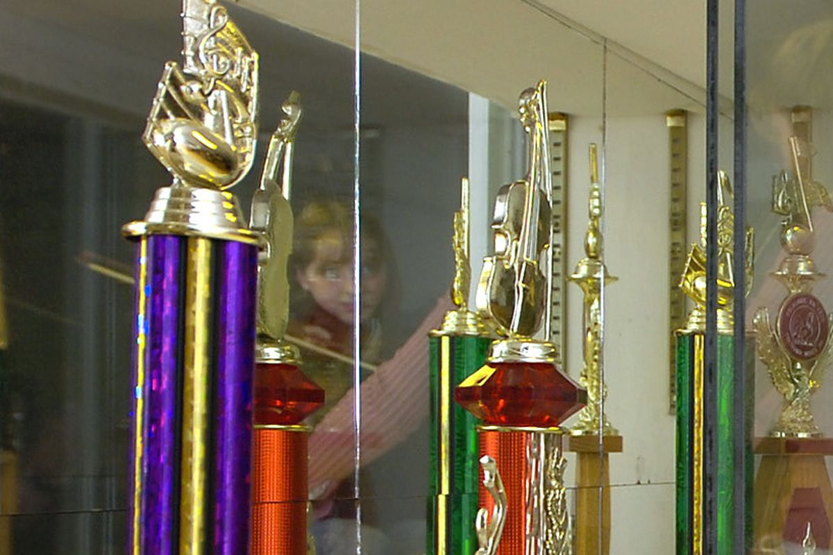 The trophy case is full of awards given to Erica Brown for her masterful fiddle playing as she teach...