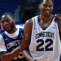 Rodney Purvis shares a laugh with Rudy Gay.