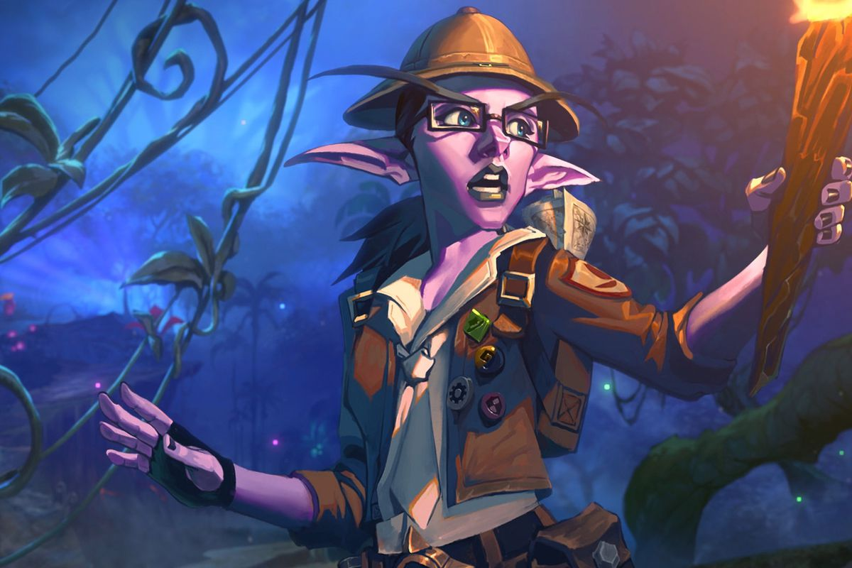 This Hearthstone: Journey to Un'Goro key art shows a night elf woman in survivalist gear. She is raising a torch into the night air, with an expression of surprise on her face, as though she has just discovered something that we cannot see. Behind her, vi