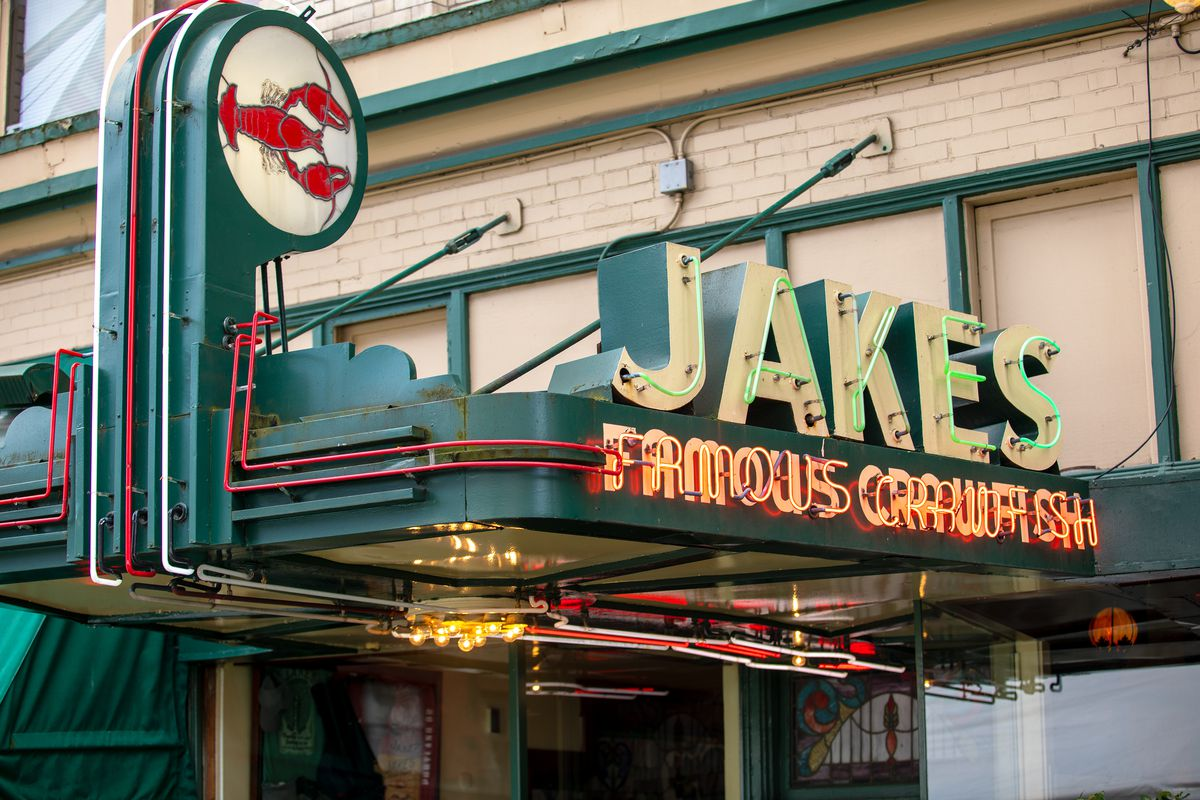 The lit sign at Jake's Famous Crawfish, with its small crawfish illustration. Jake's is located in Portland, Oregon.
