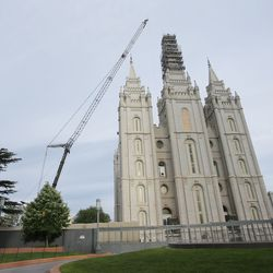 Workers from Jacobsen Construction prepare to remove the Angel Moroni statue from the Salt Lake Temple of The Church of Jesus Christ of Latter-day Saints in Salt Lake City on Monday, May 18, 2020.