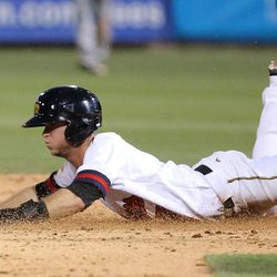 The Salt Lake Bees' Matt Williams slides safely into second base during a baseball game against the Reno Aces at Smith's Ballpark in Salt Lake City on Monday, June 26, 2017. The Bees wore Trappers jerseys for '80s throwback night.