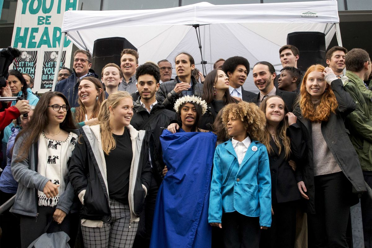In this Oct. 29, 2018, file photo, young plaintiffs stand on the steps of the United States District Courthouse during a rally in Eugene, Ore., to support a high-profile climate change lawsuit against the federal government.