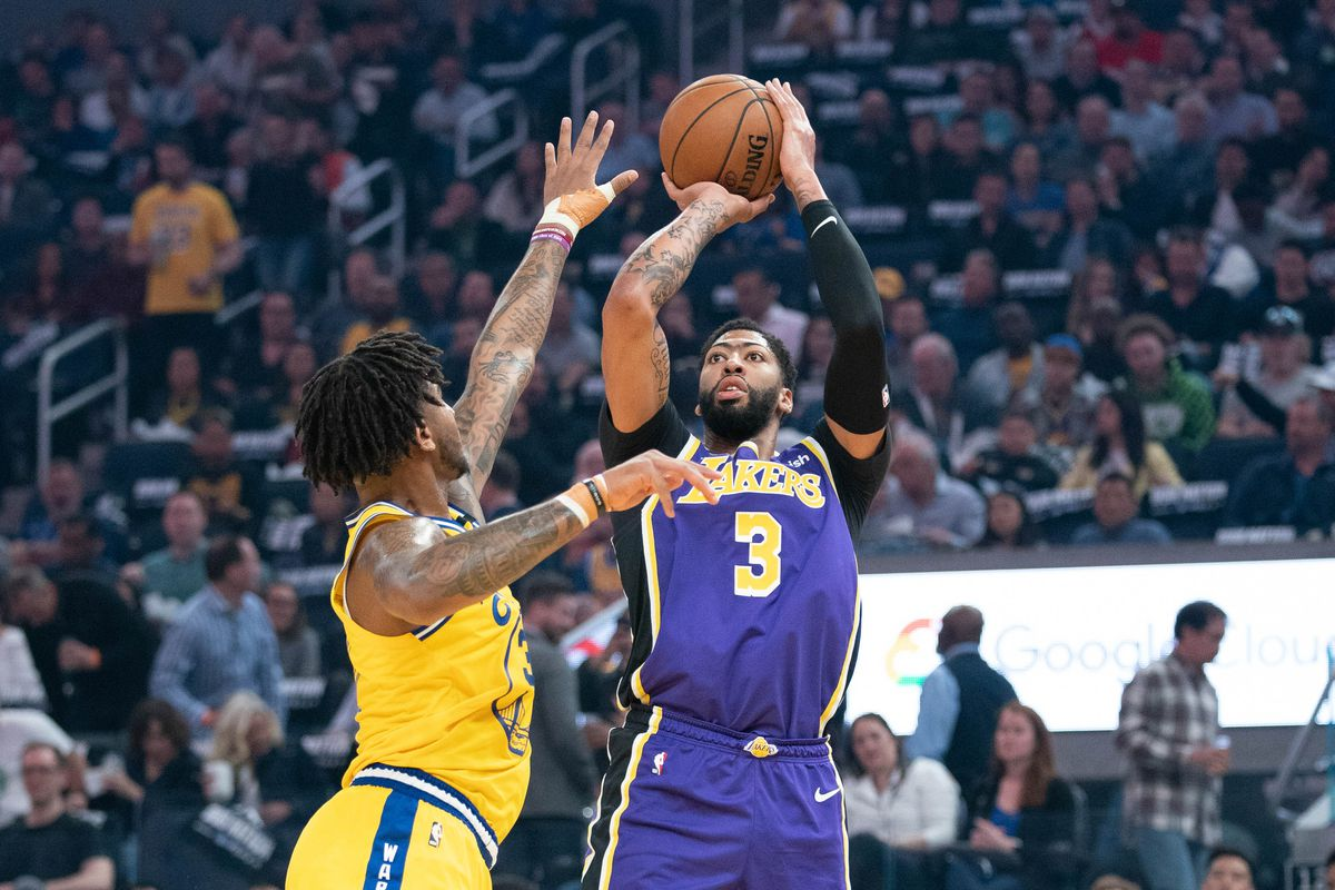 Los Angeles Lakers forward Anthony Davis shoots the basketball against Golden State Warriors forward Marquese Chriss during the first quarter at Chase Center.