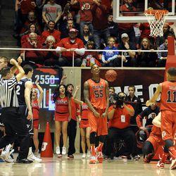 Utah Utes guard Delon Wright (55) celebrates a basket by teammateUtah Utes center Dallin Bachynski (31) during a game at the Jon M. Huntsman Center on Saturday, Dec. 14, 2013.