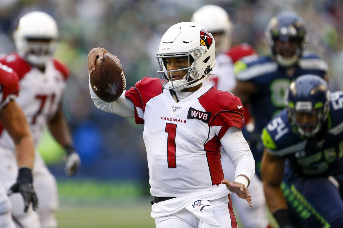 Arizona Cardinals quarterback Kyler Murray scrambles out of the pocket against the Seattle Seahawks during the second quarter at CenturyLink Field.