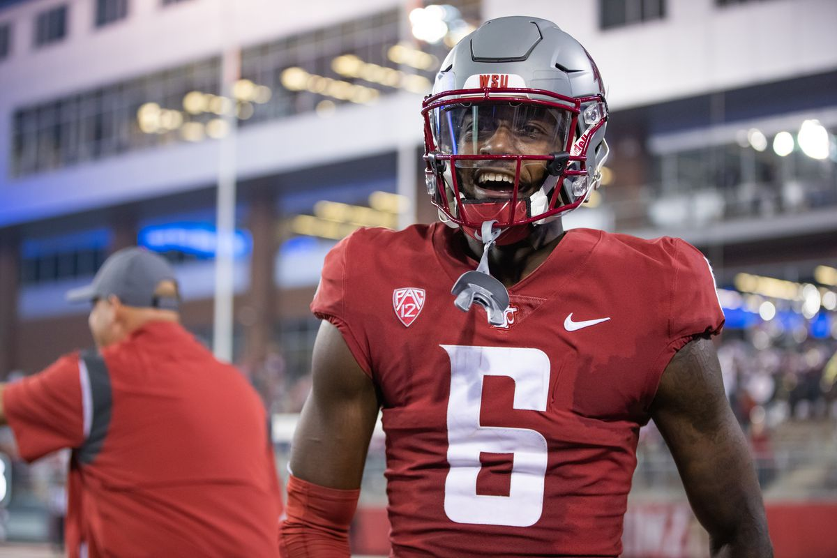 PULLMAN, WA - SEPTEMBER 4: Washington State wide receiver Donovan Ollie (6) smiles during the fourth quarter of a non-conference matchup between the Utah State Aggies and the Washington State Cougars on September 4, 2021, at Martin Stadium in Pullman, WA.
