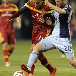 Real Salt Lake's Javier Morales and Sporting KC's Oriol Rosell fight for the ball during a game at Sporting Park in Kansas City, Kan., on Saturday, April 5, 2014.